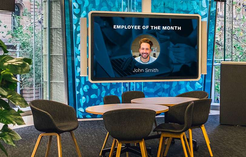 digitla display in a breakout office area showing employee of the month